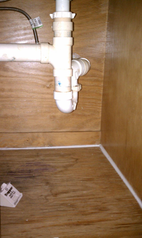 Caulking under sink