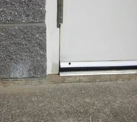 Sweeps should brush the ground and span the entire door