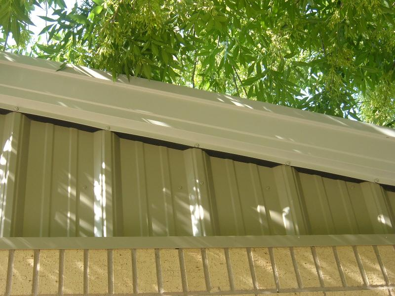 Make sure gaps like these between the siding and roof trim are sealed so bats don't make themselves at home in your school. Photo courtesy of Texas AgriLife Extension Service